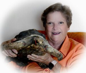 elaine a powers with red foot tortoise