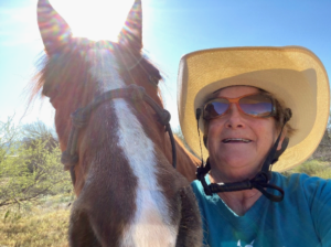 Selfie of Elaine Powers with her horse Button