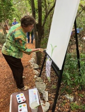 Author Elaine Powers at easel