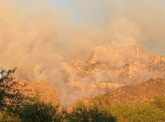 image of smoke spewing from Pusch Ridge