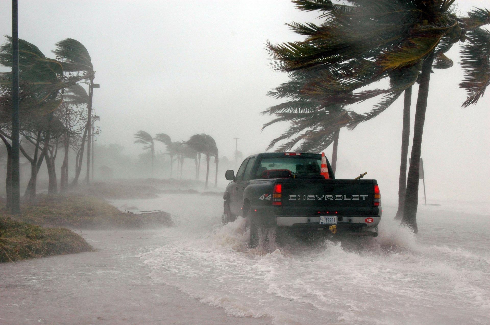 photo of truck driving through hurricane